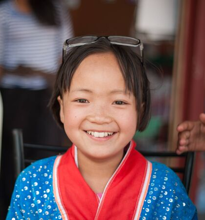 11 year old girl: Portrait of Asian Girl Smiling