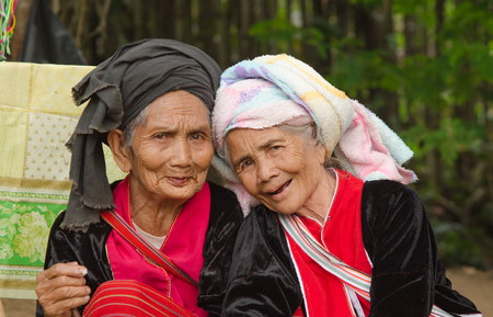 insist: CHIANGMAI,THAILAND - OCTOBER 22, 2014: Unidentified Palaung old women in the Palaung traditional costume pose for the camera. Palaung people is a minority ethnic group living in northern Thailand. Editorial