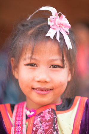 rin: BAAN HUAY NAM RIN ,CHIANG DAO,CHIANGMAI,THAILAND - JANUARY 20 ; Portrait of a Lisu tribe young girl looks at camera on January 20,2015 in Bann Huay Nam Rin,Chiang dao,Chiangmai,Thailand