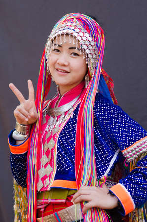 insist: CHIANGMAI,THAILAND - DECEMBER 12, 2014: Unidentified Palaung teenager in the Palaung traditional costume poses for the camera. Palaung people is a minority ethnic group living in northern Thailand.