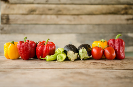 wilted: Wilted vegetables on a wooden table Stock Photo