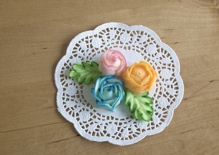 dexterity: roses and leaves made with butter and sugar, to colored decorated cakes.