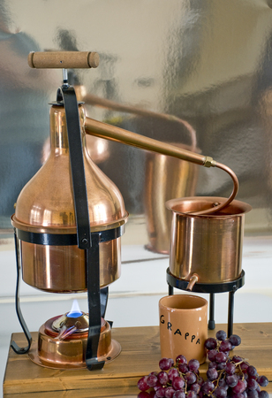 the copper alembic for the distillation of grappa. Stok Fotoğraf