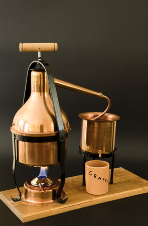 essences: the copper alembic for the distillation of grappa. Stock Photo