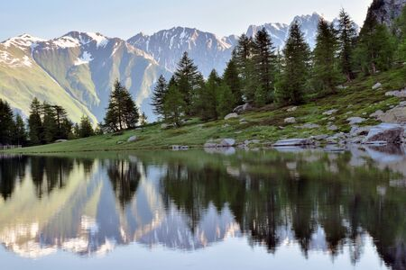 reflections on the calm waters of the lake Arpy valley d Aosta.