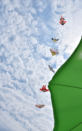 aerodynamic: kites in the blue sky with white clouds