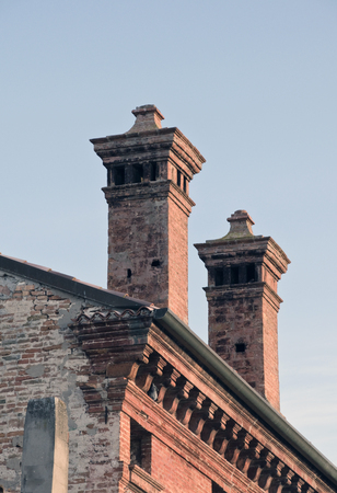 the red brick chimneys on the roof of the old palace.