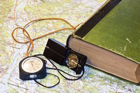 altimeter: the compass and the altimeter on the road map, to organize the excursion. Stock Photo