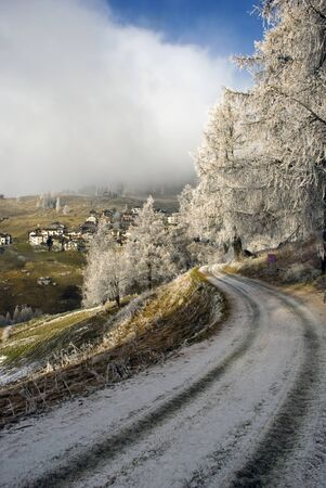 Alpine scenery with snow, fog and the blue sky