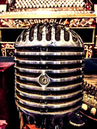 Retro microphone with other instruments in the background.