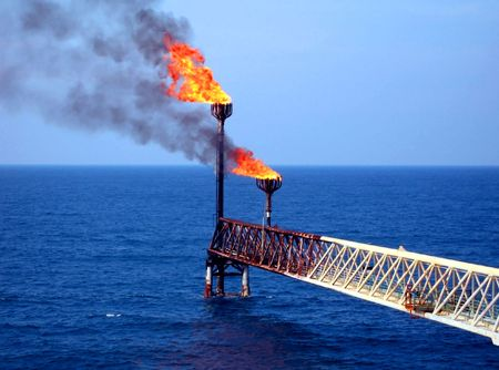 oilwell: flare on the sea Stock Photo
