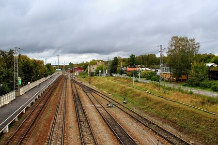 Railroad track on a cloudy autumn morning in a small town