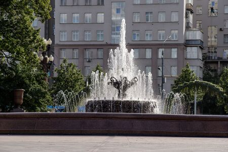 The fountain in the form of a bowl adorns the city square, which is an element of the urban landscape. Moscow.