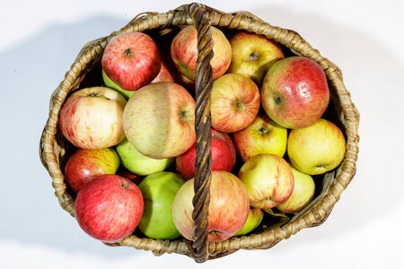 Basket full of different types of apples, top views