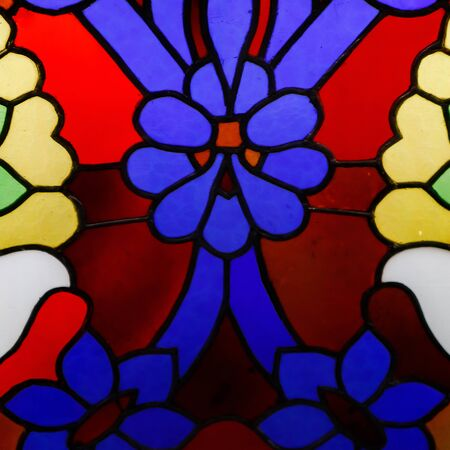 Detail of a stained glass window, bright colors, shot close-up.