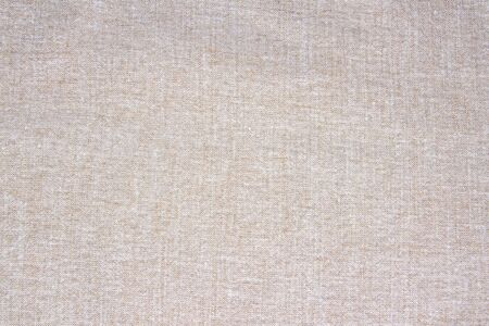 Natural vintage linen burlap textured fabric texture, detailed old grunge rustic background in tan, beige, yellowish canvas copy space