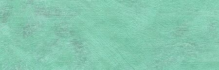 Abstract grungy decorative texture. Textured paper with copy space. Motley green paper surface, texture closeup.