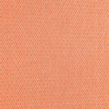 Abstract grungy decorative texture. Textured paper with copy space. The mottled surface of the paper is orange, texture closeup.