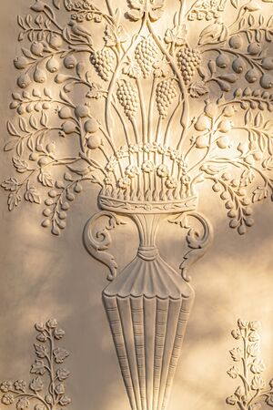 Elements of architectural design of buildings, stucco, stucco ornaments and patterns, wall texture. On the streets of Moscow, in public places. Reklamní fotografie