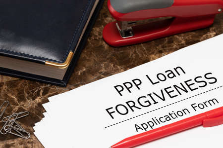 PPP loan forgiveness text on application form paper. Small Business Payroll Protection Program. Banking and finance concept Standard-Bild