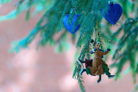 Christmas tree decoration, figurine of a couple in love who are skating. Merry christmas and happy new year greeting card.