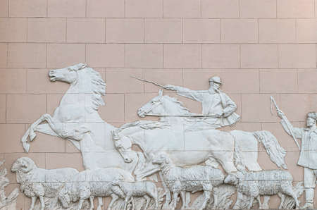 Moscow, Russia, September 30, 2020: Exhibition of Achievements of the National Economy, VDNKh. Popular sights of Moscow. Life of the Kazakh people. Marble bas-relief on the Kazakhstan pavilion
