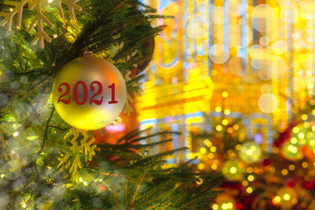 Happy New Year 2021. Numbers 2021 on abstract multicolored background of blurred bokeh of garland lights. New year holiday concept, copy space, banner 스톡 콘텐츠