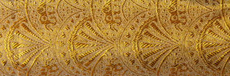 Gold floral ornament brocade textile pattern. Close-up, banner format
