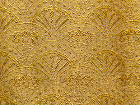 Gold floral ornament brocade textile pattern, beautiful expensive fabric background.