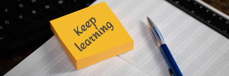 KEEP LEARNING. Close-up of a memory stick with the text. Education, Courses, Online Training and Languages Concept