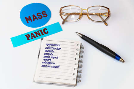 Mass panic. Signs and accessories in the form of a list on a sheet of notepad. Spontaneous, collective fear, volatility, rumors, hostility, and other common phenomena.