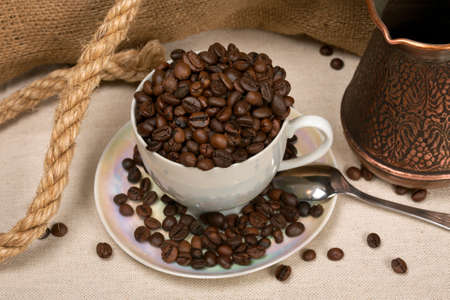 fragrant: Cup of fried fragrant coffee in grains for a grinding