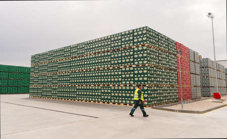 haskovo: A worker is passing by packs with bottles Staropramen beer are seen in the Molson Coors Kamenitza brewery storage lot, April 28, 2015, near the city of Haskovo, Bulgaria. Kamenitza brewery has been founded in 1881, and Molson Coors Brewing Company bought