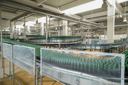 near beer: A conveyer belt with pasteurized beer in bottles is seen during production process in the Molson Coors Kamenitza brewery, April 28, 2015, near the city of Haskovo, Bulgaria. Editorial