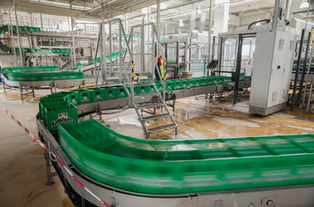A conveyer belt with packs for beer is seen during production process in the Molson Coors Kamenitza beer brewery, April 28, 2015, near the city of Haskovo, Bulgaria.