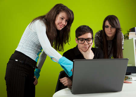 Group of three young people in the office photo
