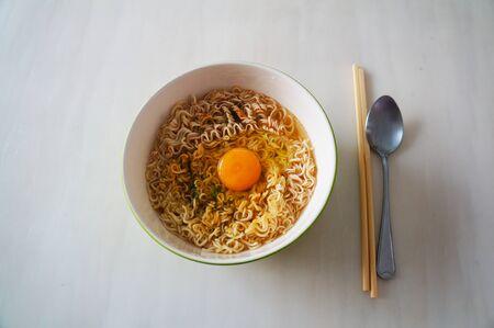 instant noodle: instant noodle soup lunch egg spoon chopstick Stock Photo