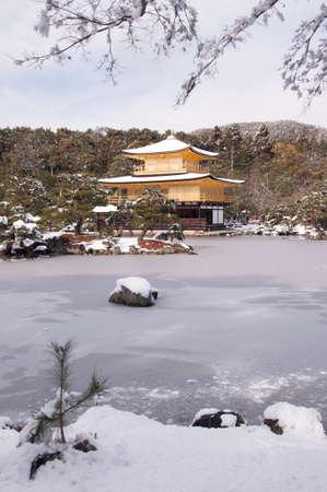 snowing: kinkakuji temple kyoto wintertime snowing concept