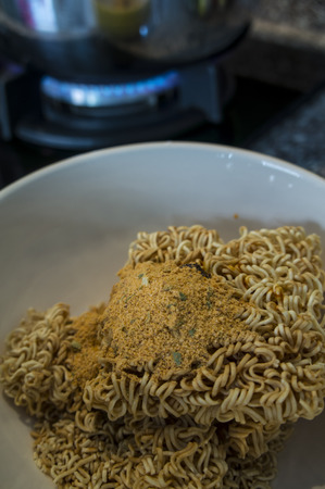 instant noodle: cooking instant noodle boiling water stove gas