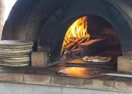 fire place: pizza making fire wood burn fire place sauce cooking