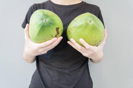 female breast: woman breast coconut fruit implant upsize metaphor