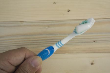 held: toothbrush brush held hold dental dentist handhold Stock Photo