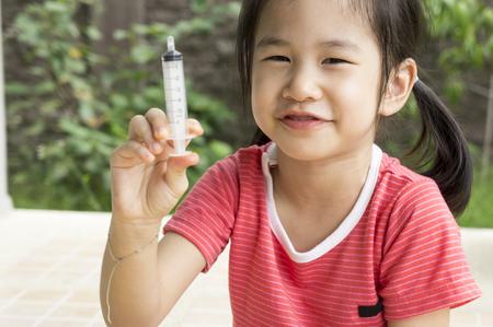 medicated: Asian child girl childhood medicine cold fever