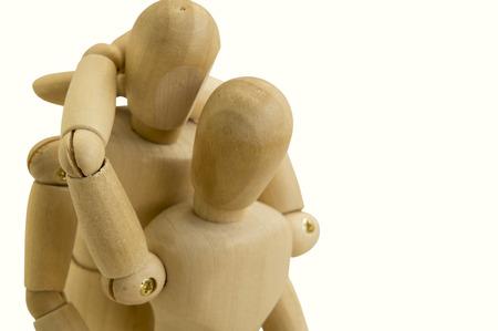 stickmen: wooden dummy couple hug eachother love care Stock Photo
