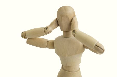 wooden figure: wooden figure concept no hear gesture  covered ear