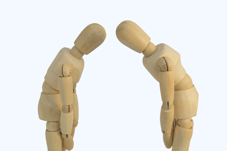 stickmen: two wooden figure bow each other