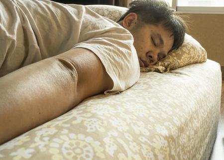pyjama: a man laying sleeping in warm bed Stock Photo