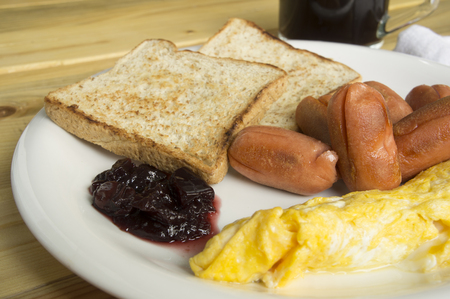 protien: breakfast sausages egg toast on plate