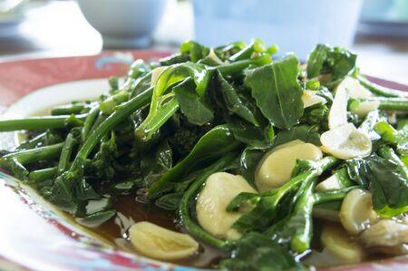 stir fry: stir fry Gourd vegetable with fresh garlic Stock Photo