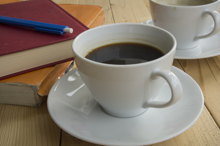 ceremic: cup of coffee in morning with book pen Stock Photo